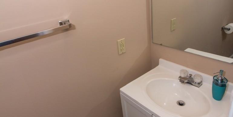 Half Bathroom behind Laundry Room