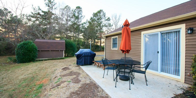 Patio with outdoor furniture and BBQ gas grill